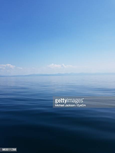 scenic view of sea against blue sky - horizon over water stock pictures, royalty-free photos & images