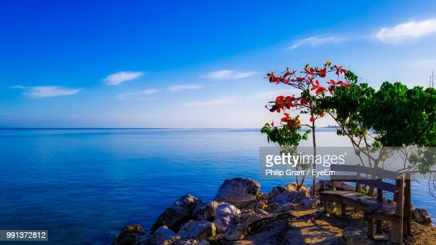 scenic view of sea against blue sky - jamaica stock pictures, royalty-free photos & images