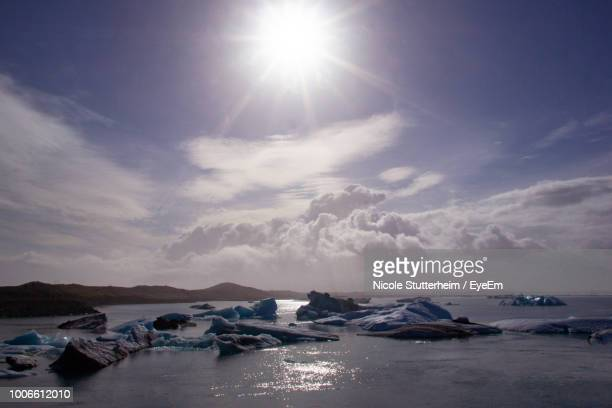 scenic view of sea against bright sun - stutterheim stock photos and pictures