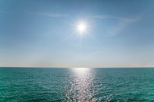 Scenic View Of Sea Against Clear Blue Sky and Sunlight - gettyimageskorea
