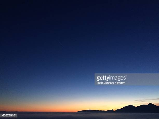 scenic view of sea against clear blue sky during sunset - lienhard stock pictures, royalty-free photos & images