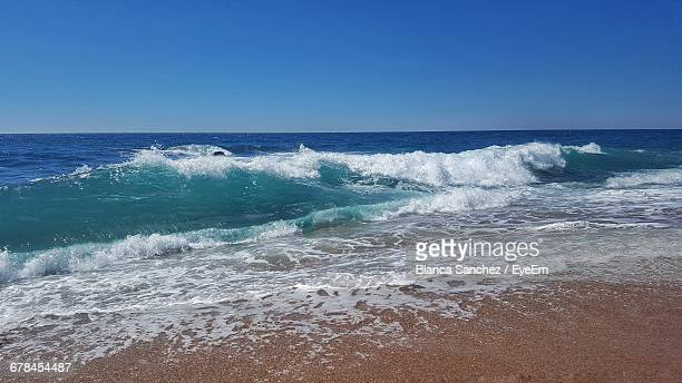 Scenic View Of Sea Against Clear Blue Sky On Sunny Day