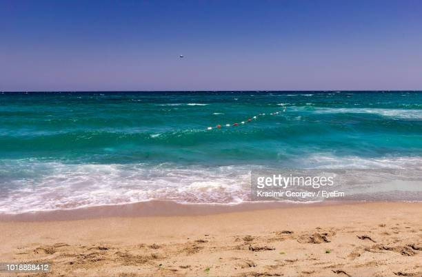scenic view of sea against clear blue sky - krasimir georgiev stock photos and pictures