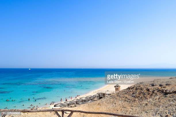 scenic view of sea against clear blue sky - red sea stock pictures, royalty-free photos & images