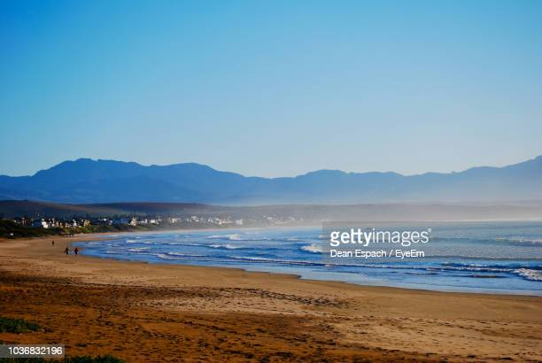 scenic view of sea against clear blue sky - mossel bay stock pictures, royalty-free photos & images