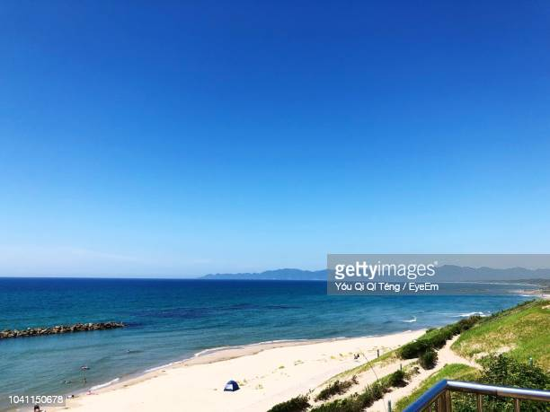 scenic view of sea against clear blue sky - 青 ストックフォトと画像