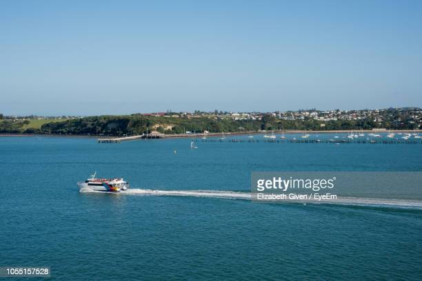 scenic view of sea against clear blue sky - waitemata harbor stock photos and pictures