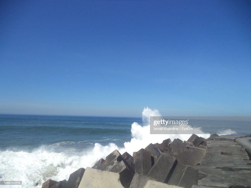 Scenic View Of Sea Against Clear Blue Sky : Stock Photo