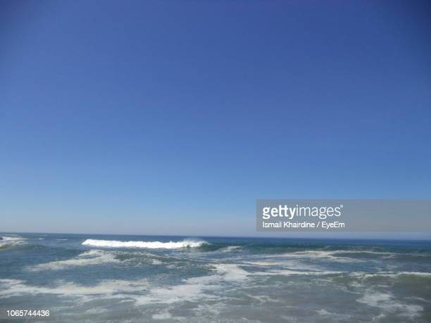 scenic view of sea against clear blue sky - ismail khairdine stock photos and pictures