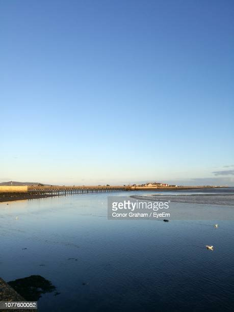 scenic view of sea against clear blue sky - conor stock pictures, royalty-free photos & images