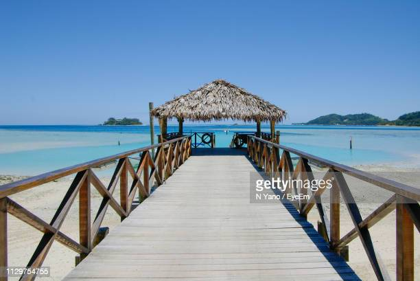 scenic view of sea against clear blue sky - fiji stock pictures, royalty-free photos & images
