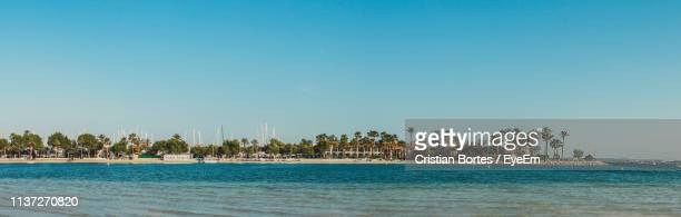 scenic view of sea against clear blue sky - bortes stock pictures, royalty-free photos & images