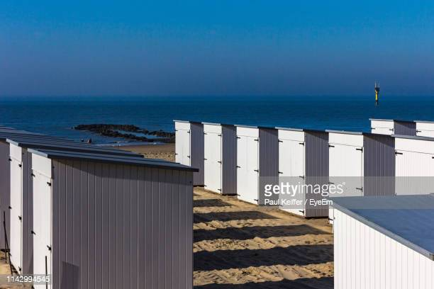 scenic view of sea against clear blue sky - keiffer stock-fotos und bilder
