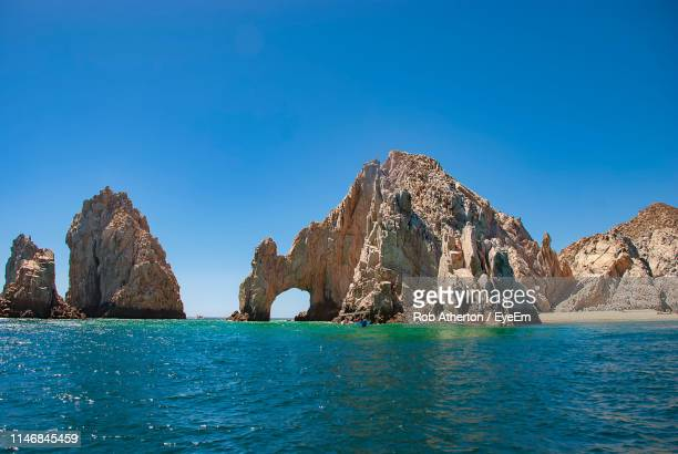 scenic view of sea against clear blue sky - cabo san lucas stock pictures, royalty-free photos & images
