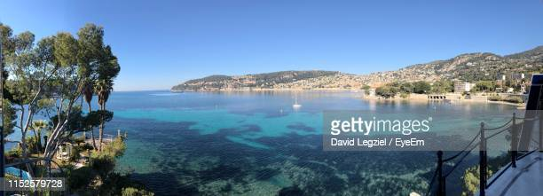 scenic view of sea against clear blue sky - saint jean cap ferrat stock pictures, royalty-free photos & images