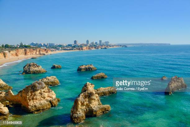 scenic view of sea against clear blue sky - alvor stock pictures, royalty-free photos & images