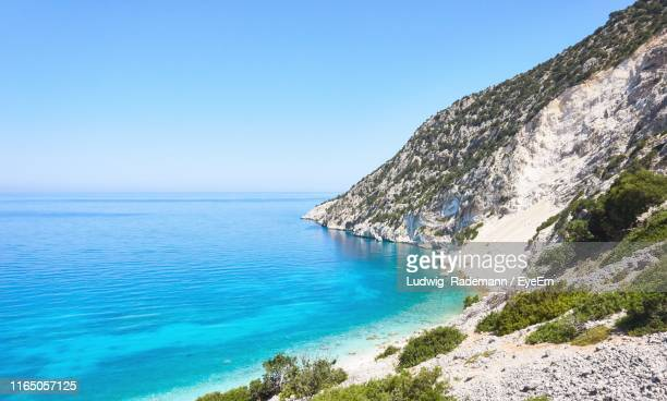scenic view of sea against clear blue sky - rademann stock pictures, royalty-free photos & images