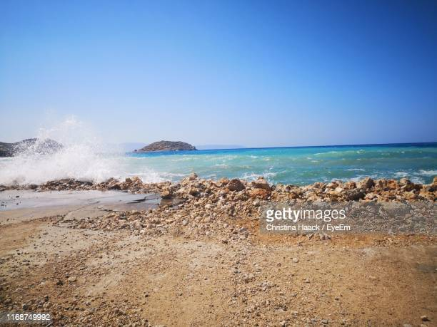 scenic view of sea against clear blue sky - haack stock pictures, royalty-free photos & images
