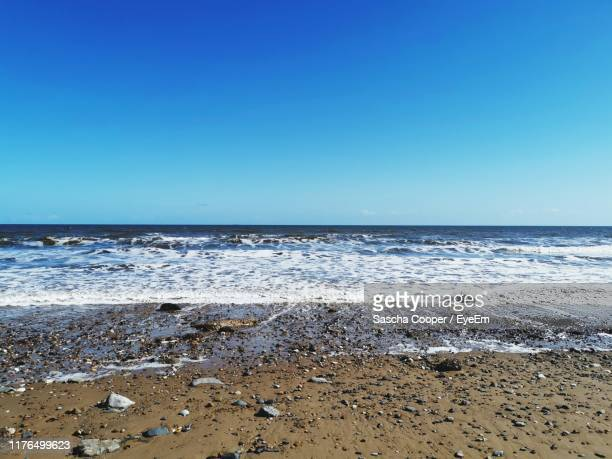 scenic view of sea against clear blue sky - bridlington stock pictures, royalty-free photos & images
