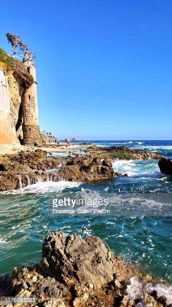 scenic view of sea against clear blue sky - laguna beach california stock pictures, royalty-free photos & images