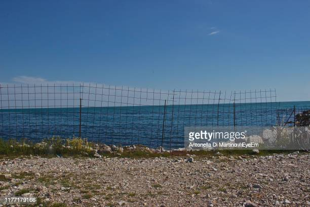 scenic view of sea against clear blue sky - antonella di martino foto e immagini stock