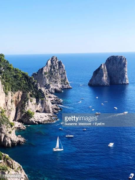 scenic view of sea against clear blue sky - capri stock pictures, royalty-free photos & images