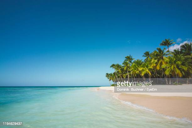 scenic view of sea against clear blue sky - idyllic stock-fotos und bilder