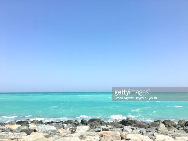 scenic view of sea against clear blue sky - jessa stock pictures, royalty-free photos & images