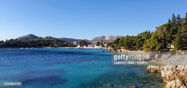 scenic view of sea against clear blue sky - ljubomir belic stock pictures, royalty-free photos & images