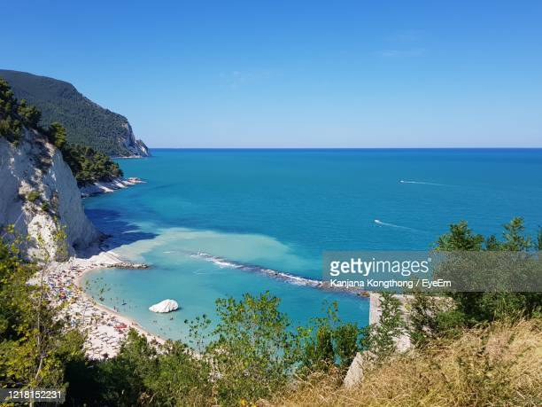 scenic view of sea against clear blue sky - kanjana kongthong ストックフォトと画像