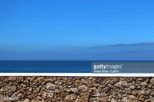 scenic view of sea against clear blue sky - 防波堤 ストックフォトと画像