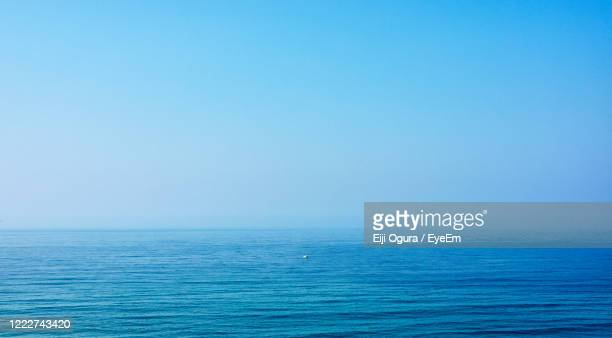 scenic view of sea against clear blue sky - 海 ストックフォトと画像