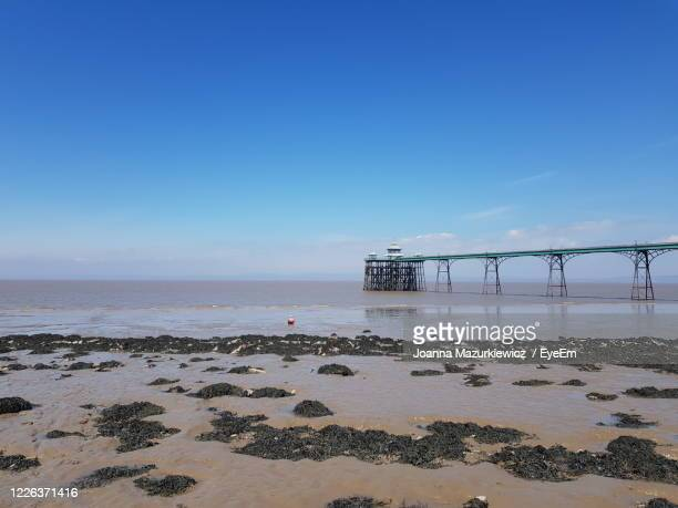 scenic view of sea against clear blue sky - clevedon pier stock pictures, royalty-free photos & images