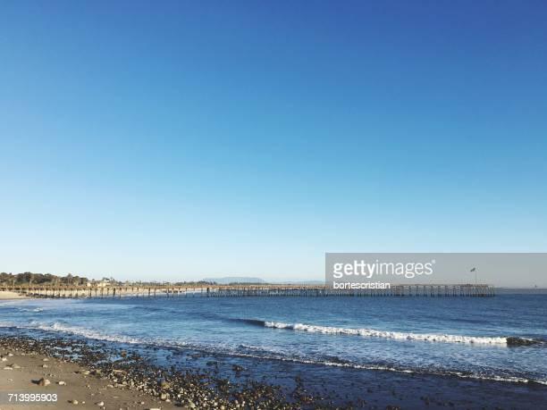 scenic view of sea against clear blue sky - bortes foto e immagini stock