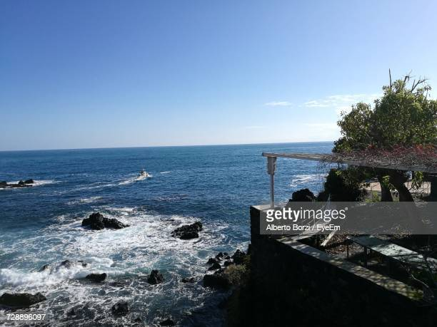 scenic view of sea against clear blue sky - acireale stock-fotos und bilder