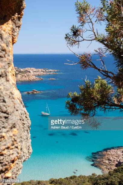 scenic view of sea against clear blue sky - corsica photos et images de collection