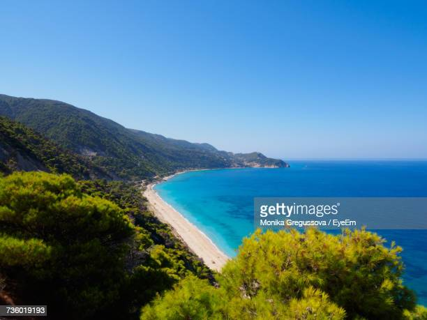 scenic view of sea against clear blue sky - monika gregussova stock pictures, royalty-free photos & images