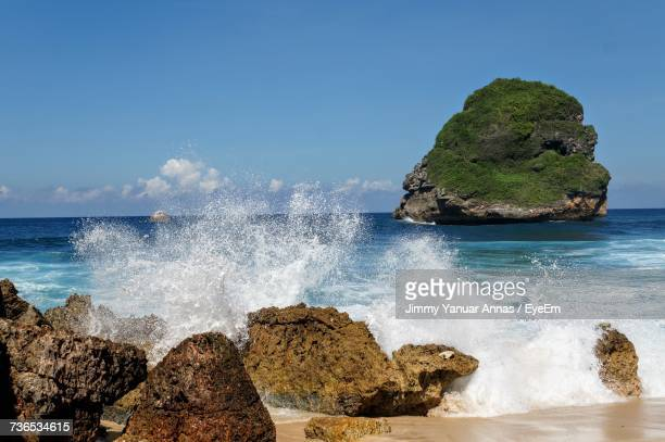 scenic view of sea against clear blue sky - east java province stock photos and pictures