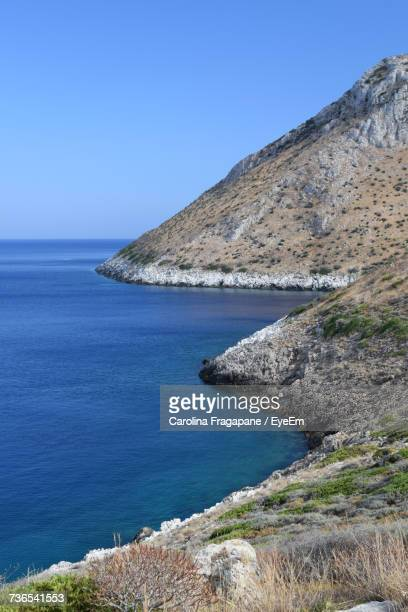 scenic view of sea against clear blue sky - carolina fragapane stock pictures, royalty-free photos & images