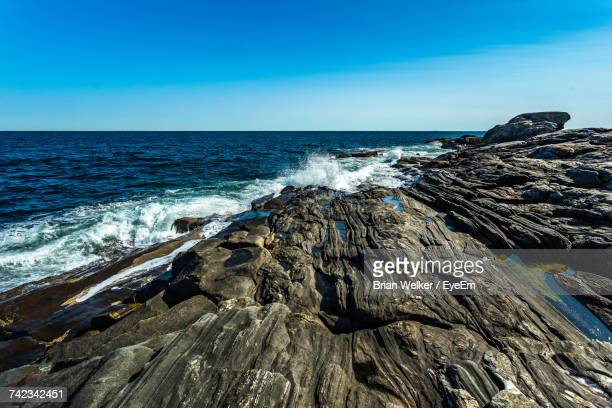 scenic view of sea against clear blue sky - boothbay harbor stock-fotos und bilder