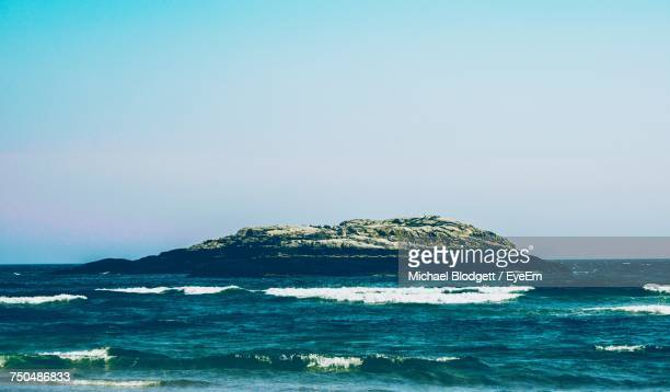 scenic view of sea against clear blue sky - michael blodgett stock pictures, royalty-free photos & images