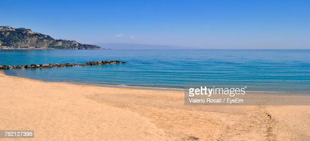scenic view of sea against clear blue sky - giardini naxos stock pictures, royalty-free photos & images