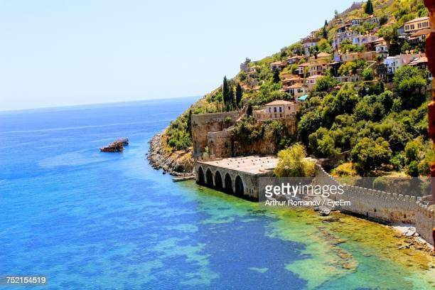 scenic view of sea against clear blue sky - antalya province stock pictures, royalty-free photos & images