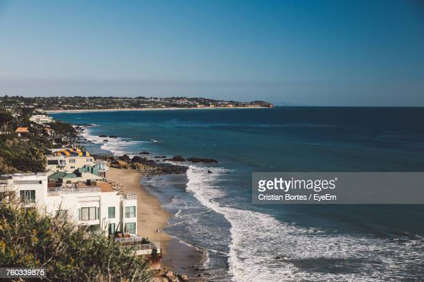 scenic view of sea against clear blue sky - malibu stock pictures, royalty-free photos & images