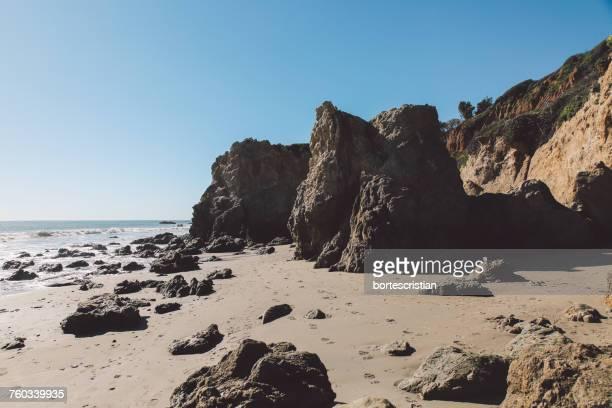 scenic view of sea against clear blue sky - bortes bildbanksfoton och bilder