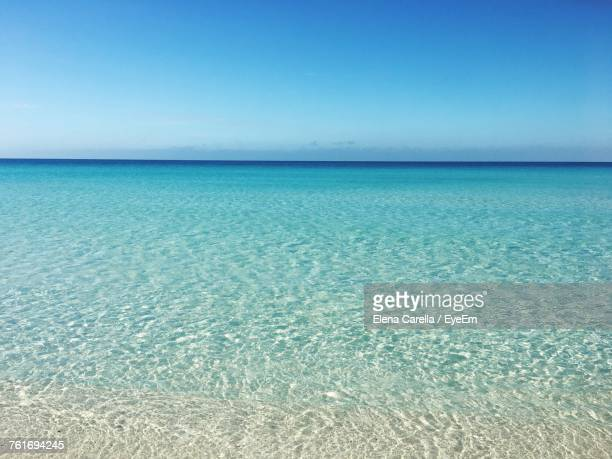 scenic view of sea against clear blue sky - clear sky stock pictures, royalty-free photos & images