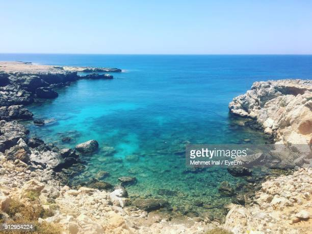scenic view of sea against clear blue sky - republic of cyprus stock pictures, royalty-free photos & images