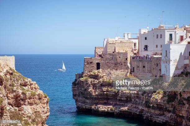 scenic view of sea against clear blue sky - polignano a mare stock photos and pictures