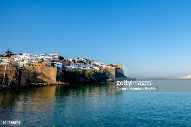 scenic view of sea against clear blue sky - rabat morocco stock pictures, royalty-free photos & images