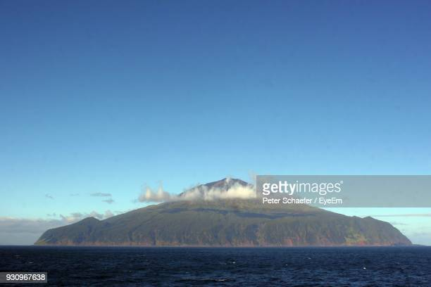 scenic view of sea against clear blue sky - tristan da cunha eiland stockfoto's en -beelden